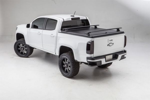 Track system tonneau cover