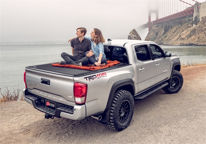 Sitting on top of the tonneau cover